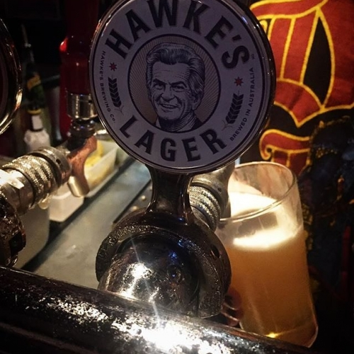 """""""Nothing's more Australian than having a Hawke's Lager poured by a man in a heavy metal shirt at the iconic Corner Hotel on your way to a football match... roundball football match."""" Any counts mate! Couldn't have said it better ourselves. 📷: @johnnybarrington . . . . . #cornerhotel #melbourne #beer #drinks #weekend"""