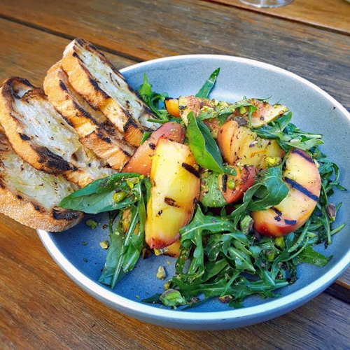 *Heading to the Corner.. gonna eat their grilled peach salad* sung to the tune of Peaches by The Presidents of the United States of America going through our heads right now.  Now featuring on our newly updated menu! 🍑