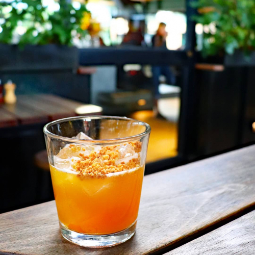 Q. When you move to the country, what do you eat a lot of? 🤔  Behold the 'Movin' To The Country,' featuring butterscotch schnapps, Napoleon brandy, peaches, golden syrup, orange and biscuit crumble.  Damn tasty, 100% vegan and on our cocktail menu now.