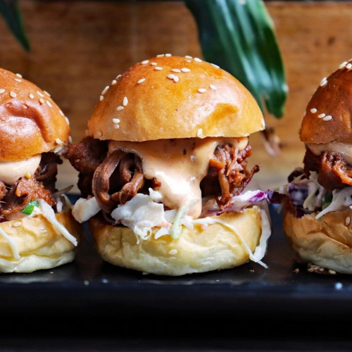 SLIDER-ING INTO YOUR INSTA FEED; smokey beef brisket sliders with buttermilk slaw and chipotle mayo. 🤤  The perfect pre-show snack, on the menu right now.