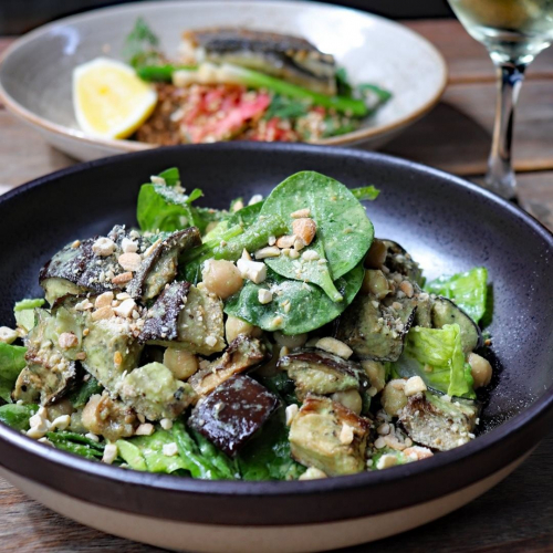 CHICK(PEA) IT OUT; Roasted eggplant salad with chickpeas, spinach, asparagus, cashews and a sesame dressing.  Perfect thing for a warm evening, available on our seasonal menu right now.